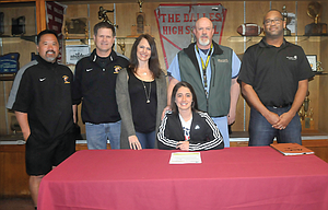 The Dalles point guard Kailin Hoylman signed a scholarship deal to play basketball for Chemeketa Community College. The first-team all-league winner and Riverhawk team Most Valuable Player is surrounded by, pictured from left to right, coach Dan Telles, coach Craig Compton, mother Lynn Hoylman, father Roger Hoylman and Chemeketa head coach Kevin McCarrell.