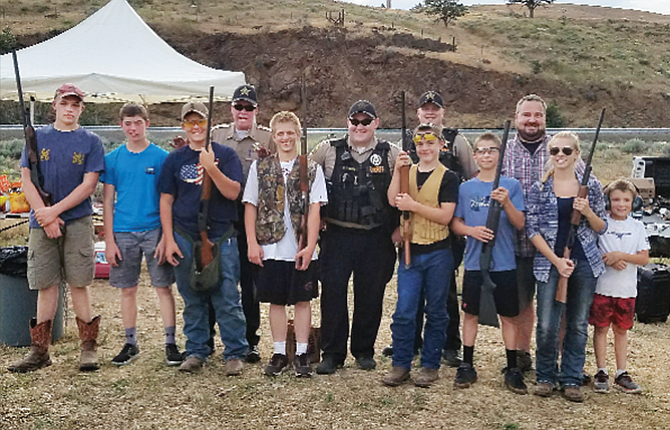 Dufur Clay Target shooters and Wasco County officers, pictured from left to right, Cole Morrison, Louis Red Cloud, Karl Wilson, Lane Magill (Wasco County Sheriff), Andrew Richman, Ray Thomas (Wasco County Deputy), Parker Wallace, Jeff Hall (Wasco County Sergeant), Kyler Powell, Robert Wallace (Coach), Jessica Elam and Kyle Wilson (Karl Wilson's Little Brother) participated in a fun night competition Wednesday evening in Dufur. The team heads to state on June 24 in Hillsboro. Not in the photo are: Tanner Masterson, Ben Schanno, Caleb Olson and Peyton Neal.