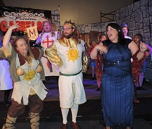 """King Arthur (William Thayer-Daugherty) belts one out with Lady of the Lake (Emily Vawter), right, Patsy (April Sampson), left, Dennis (Peter Tappert) and Lance (Jimmie Oates) in a Vegas-style number in """"Spamalot"""" opening Saturday."""