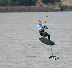 AT THE HOOD RIVER EVENT SITE, a kiteboarder leaps out of the water with a hydrofoil attached to his board. Hydrofoils will make an appearance at this year's Beach Bash, with the new Foil Fest event happening Friday to help attendees learn about the devices — particularly their application to windsurfing.