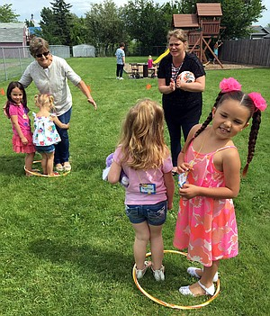 Grangeville Church of the Nazarene held its annual vacation Bible school program last week, June 5-8, with 56 children and a large group of volunteers participating. Here, kids and helpers have fun during recreation time on the church lawn.