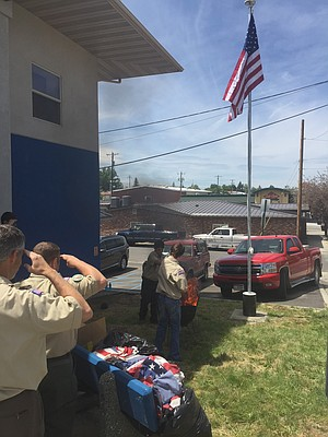 Boy Scout Troop 555 conducted a public flag retirement ceremony Wednesday afternoon, June 14, at the Idaho County Veterans Center in Grangeville. Time allowed the scouts to retire 57 worn-out flags that were brought to the Veterans Center, and they have about a dozen more still to finish.