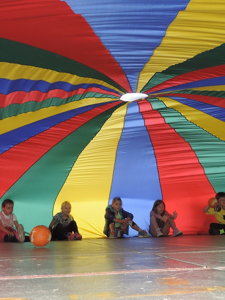 Among other activities at Westside Elementary's Thursday field day, students took turns playing games beneath a parachute, sitting on the edges of the material, keeping it taut to create a domed space. Friday was the final day of classes in the Hood River County School District.
