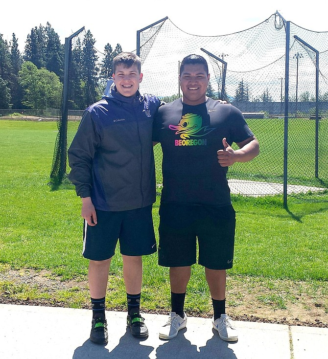 HENRY BUCKLES (left) and Sebastian Barajas pose for a photo at Hood River Valley High School's throwing facilities.