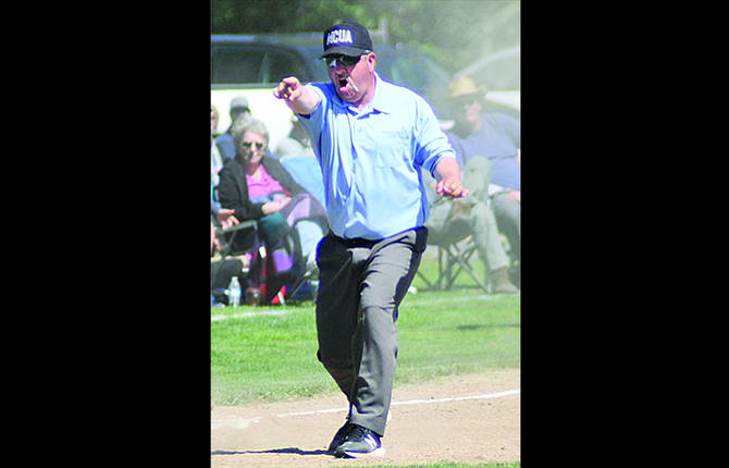 The Dalles native Robert Jamack sends in a baserunner after a ball went out of play in 2A action earlier this year in Dufur. In a pregame ceremony last weekend in Hillsboro, Jamack was awarded the Oregon Athletic Officials Association Official of the Year for the 2016-2017 athletic campaign. This was the first such award won by a MCUA member.