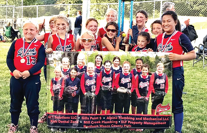 Softball players from the 10U Cherry City Crush traveling team amassed a 5-0 record and outscored opponents by a 69-34 margin to capture first-place honors at the Donald Duck Invitational held last weekend in Newberg. The team capped their championship with an 11-7 triumph against the McMinnville Grizz. In the group photo are, starting in the back row, Jaydon Hansen, Mackenzie Barrett, Sydney Newby, Lily Marx and Ava Graves. In the front row are, from left, Siyra Faulkner, Maddie Brock, Bryce Newby, Keily Lutgens, Makiah Iven and Despina Seufalemua.