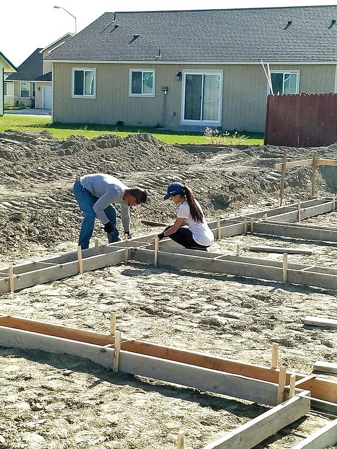 Sarah and Alex Herrera can't wait to complete the construction of their new homes in the South Hill Housing development, thanks to a Catholic Charities Housing programs. The couple spend each minute they can spare working on laying the foundation of their new home.
