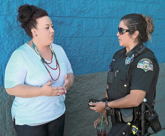 Jensena Newhouse and Sunnyside police officer Melissa Rivas were among the fundraiser volunteers helping at the Gonzalez-Castillo fundraiser Sunday at Walmart.