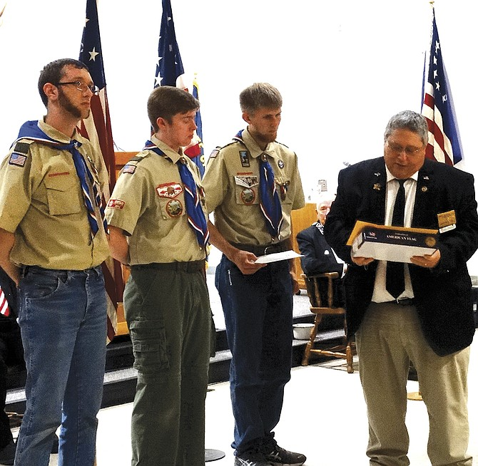 Lars Haugen, Calvin Baker and Grayson Mann receive a flag flown in their honor over the U.S. Capitol, as requested by Sen. Ron Wyden, in recognition of earning their Eagle Scout awards. The flags were given to the young men following the Flag Day ceremony at the Independence Elks Lodge in June 14.