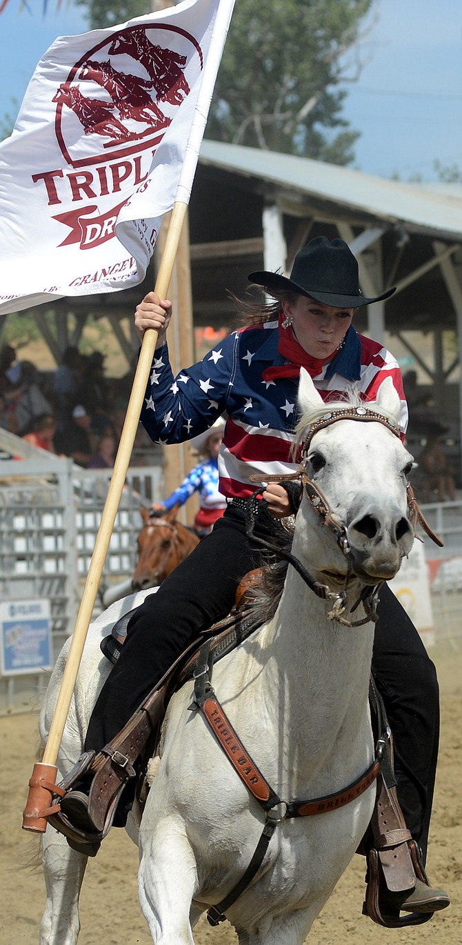 A member of the Triple Bar Drill Team performs in the 2015 Border Days Rodeo.