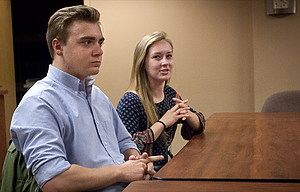 Martin Carter and Whitney Scott talk to a reporter about their upcoming missions in Argentina and Hong Kong, respectively. The two local graduates are training this summer in Utah with other members of the Church of Latter Day Saints to share the gospel in other countries.