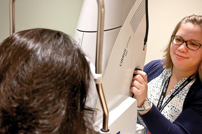Dr. Stephanie Cooper examines a patient at the newly-opened optometry clinic on the campus of the 50,000 square-foot campus of Yakima Valley Farm Workers Clinic's medical dental facility.