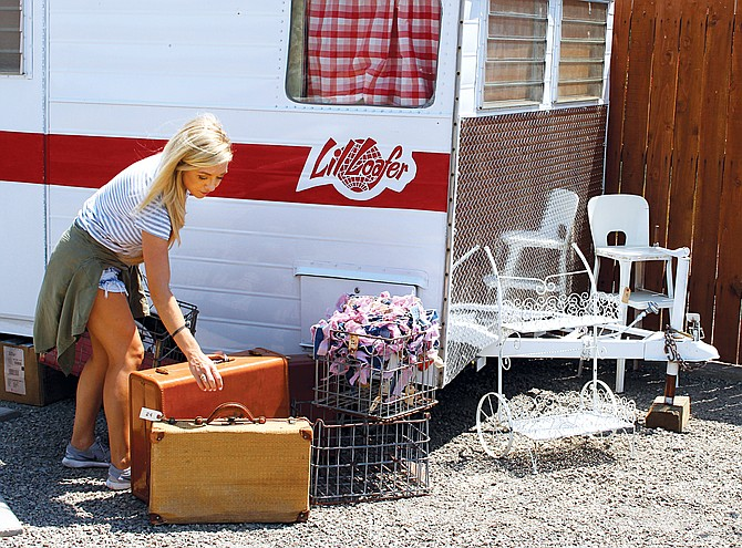 Taylor Swofford is pictured with the tiny vintage camper, which she said adds atmosphere to the French Vanilla Market's courtyard, where special events are planned soon.