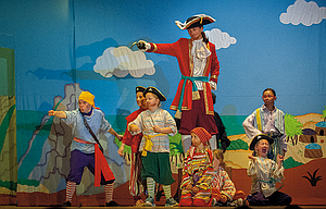 Captain Hook (Noble Williams), center, is seen with his crew of pirates, which included, in no particular order, Kate Cannon, Makenna Cramblett, Flora Crouch, Arwen Dorzab, Anneliese Richardson and Tori Thompson during Saturday's evening performance. Pictured at left is Smee, tour actor/director with Missoula Children's Theatre.
