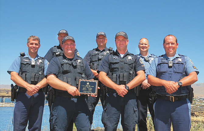 OSP Fish and Wildlife troopers from The Dalles Area Command received an award June 23 for top performance in the state, based on their 2016 enforcement activities. Pictured after the ceremony are: Back row, from left: Trooper Swede Pearson, Senior Trooper Justin Frazier and Sergeant Les Kipper. Front row, from left, are: Senior Trooper Mark Jubitz, Sr.; Senior Trooper Brent Ocheskey, Trooper Jason Walters, Sr.; and Trooper Thad Routson.
