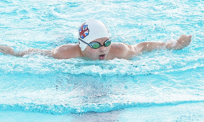 Carter Hauver of Sunnyside looks at his Grandview competitors in the 12U butterfly Tuesday. For coverage of the swim meet, see Page 12.