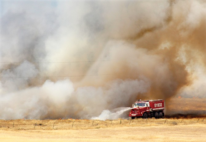 Fire crews douse flames along fire lines.