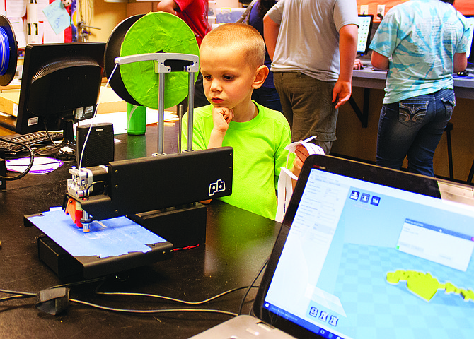 Blake Ogilvie watches a 3-D printer create a design during an exhibition night at LaCreole Middle School in 2016. The school is building a makerspace lab designed for projects that use 3-D printers, laser cutters and imagination.