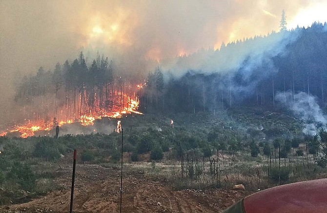 FLAMES WRITHE at the Dry Creek Fire north of White Salmon, which swelled at 500 acres Sunday but was 15 percent contained at 322 acres Tuesday.