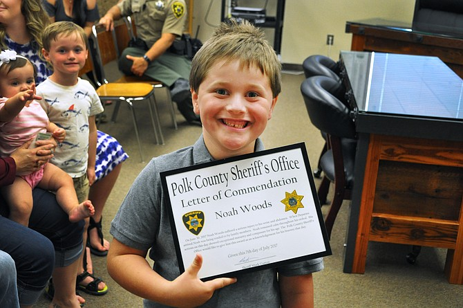 Noah Woods with his letter of commendation.