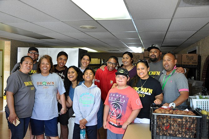 The Brown family altered their reunion plans to include volunteering to move the food bank.