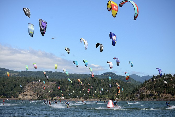 KITEBOARDING 4 CANCER participants fill the sky with kites during last year's running. The popular event returns July 15-17 to the Hood River Waterfront. Details at kb4c.org.