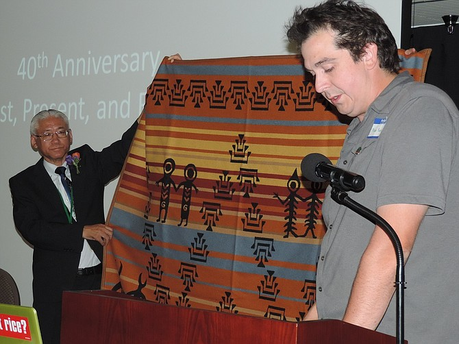 GIFTS exchanged between sister cities included a double-sided blanket made by Lillian Pitt, representing the Wasco, Yakama and Warm Springs tribes presented by Board Member Niko Yasui, Hood River, to Mayor Masamitsu Aikawa, Tsuruta.