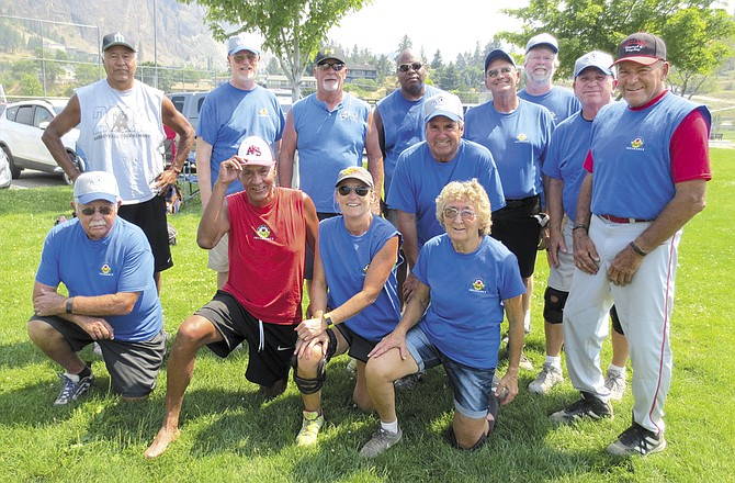 Farmers Insurance took first place on a tiebreaker in a tournament July 8-9 in Summerland, B.C. The team included (front, from left) Roy Bowden, Steve Marchand, Kristi Marchand and Shirley Bowden; (second) Edwin Marchand, Al Camp, Rick Halterman, Gary Lewis, Dave Jansen, Darrell Stanley, Mark Peter, Dale Linklater and Neil Riebe.