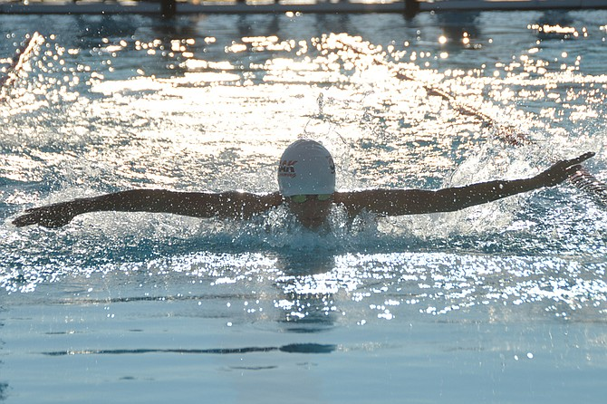 Tyler Sam of Omak swims the fly leg of a 100 IM for boys' age 13-14 during dual meet with Okanogan on July 11.