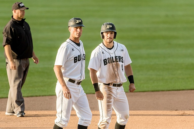 SKYLER HUNTER (No.4) confers with Purdue Boilermakers Baseball Head Coach Mark Wasikowski during a game late this spring. In his freshman year, Hunter, a 2016 Hood River Valley High School graduate, led Purdue with 65 hits and a .323 batting average. He's also a top player on the collegiate summer league team, the Palm Springs Power, where he has put up 44 hits, 24 RBIs, and amassed a batting average of .411 through 27 games.