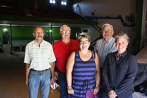 Supporters of The Dalles Civic Auditorium visited the theater Tuesday morning to celebrate being awarded a $745,000 grant from the state of Oregon that will help pay for renovations. Left to right are: Dennis Morgan, president of the Civic Auditorium Historic Preservation Committee; Mayor Steve Lawrence; committee members Lisa Commander and Leon Surber; and Elizabeth Wallis, the Civic's program manager. Below, Mahlcolm McDonald, a carpenter with Griffin Construction, works from a hydraulic lift about 30 feet off the ground.