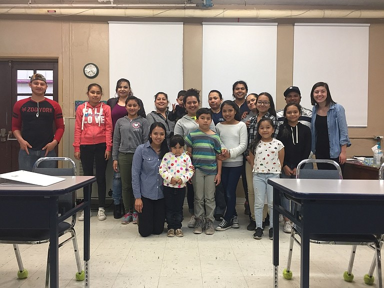 """Sara Tiscareño-Kennedy, far right, with a group ofJuntos participants. Juntos (""""together"""" in Spanish) works to empower families around education."""