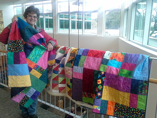 Columbia River Gorge Quilters Guild President Kim Vogel brings first four quilts to PHRMH. The Comfort Quilt Ministry is part of PHRMH Spiritual Care services for patients nearing the end of their life. Quilts may also be given to patients who have chosen to go home on hospice.