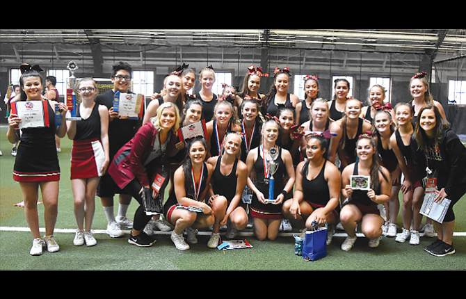 """The Dalles cheerleaders won countless team awards and added individual honors at last week's National Cheerleading Association """"Get Shocked"""" Camp at Oregon State University in Corvallis. In the photo are, starting with the top row, from left to right, Mackenzie Smith, Mia Barber, Miguel Torres, Sydney Fransen, Selah Cosgrove, Olivia Thomas, Alex McAllister, Giselle Schwartz, Karla Hernandez, Ariana Acevedo, Regina Keilman, Amber Hillegas, and Lorelay Berry.  In the middle row are, from left, head coach Kelsey Sugg, Zaida Lopez, Jordyn Hattenhauer, Emily Adams, Anna Singhurst, Breanna Birchfield, Annabelle Shearer, Emma Koch, Megan Brace and assistant coach Alli Miles. In the front row are, from left, Jessika Nañez, Kendyl Kumm, Samantha Stanley, Shivani Patel and Cary Stone. TD had 11 members nominated for All-American honors, with Nañez and Kumm earning recognition."""