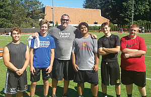The Dalles football players, from left to right, Opath Silapath, Mac Abbas, Ryan Davis, Connor Stewart and Will Dunn take a group shot with former National Football League lineman, Kevin Gogan, at the three-day trench camp from July 14-16 on the campus of Lewis and Clark College in Portland.