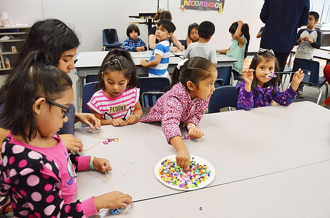 Pre-K students create art during Migrant Summer School at Mid Valley Elementary in Odell, a program now in its 30th year and serving close to 250 students.