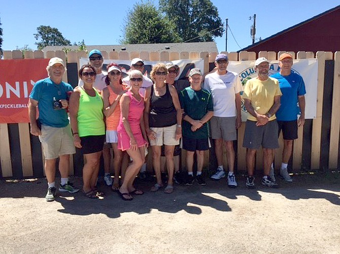 THE SPORT OF PICKLEBALL has become increasingly popular in the area, according to the Gorge Pickleball Association, which now boasts over 100 members. Above, GPA members pose for a photo during a recent tournament in Washougal.