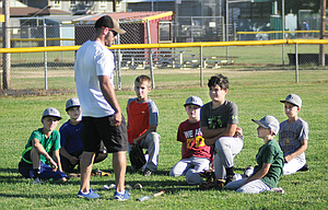 The Dalles 10U Little League All Star head coach Michael Cates, in middle, discusses strategy with his outfielders during practice at Kramer Field in The Dalles. In the photo are, from left to right, Derek Goulart, Carson Ramsay, Trey Hodges, Joshua Brackenbury, Jonah Ofisa, Hudson Case and Reese Kenslow. The Stars head out to Erv Lind Field at Normandie Park in Portland for the Oregon State Tournament this weekend. The first game is slated for 6 p.m. on Saturday.