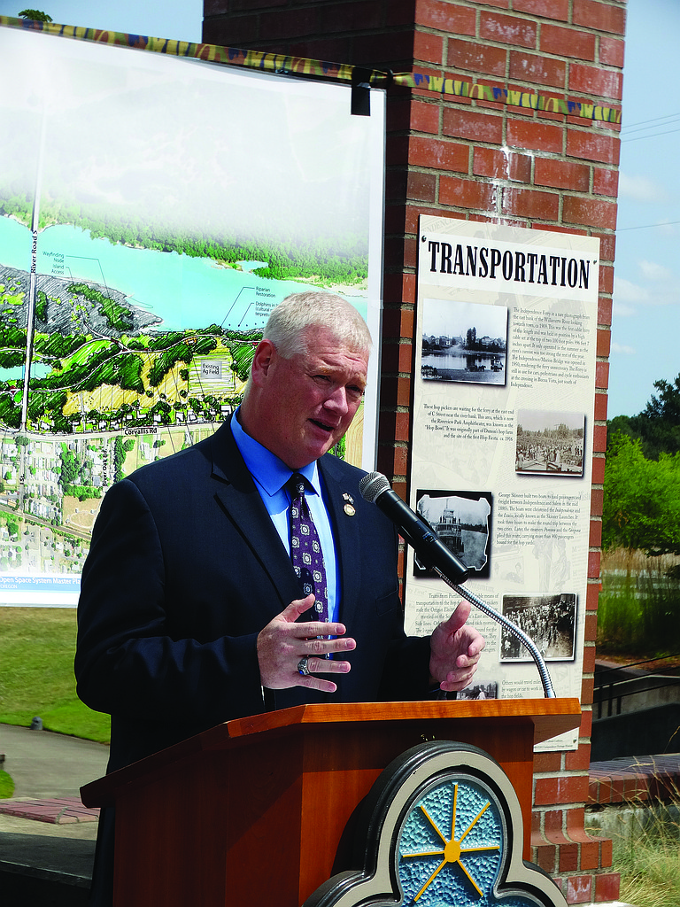 State  Rep. Paul Evans speaks Thursday at Riverview Park in Independence to announce the State Legislature has awarded the city a $1 million grant to help with continuing development of Independence Landing.