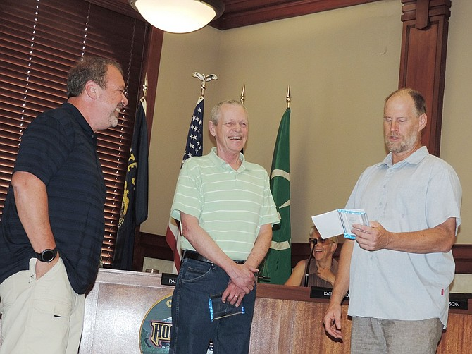 Monday's City Council meeting saw the ceremonial departure of two of Hood River's longest-termed employees: wastewater treatment plant operator Doug Nichols, center, and Dave Smock, left, public works foreman.