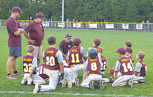 The Dalles Little League 10U All Stars gather around coaches, from left to right, Randy Goulart, Mark Coburn and head coach Michael Cates after Monday's 12-5 Oregon State Championship win over Del Norte, Calif. After losing by a 12-8 score in their opener, The Stars have defeated Ashland and Del Norte in consecutive games by a combined 25-5 margin. TD hits Erv Lind Field in Portland at 6:30 p.m. tonight against Sprague.