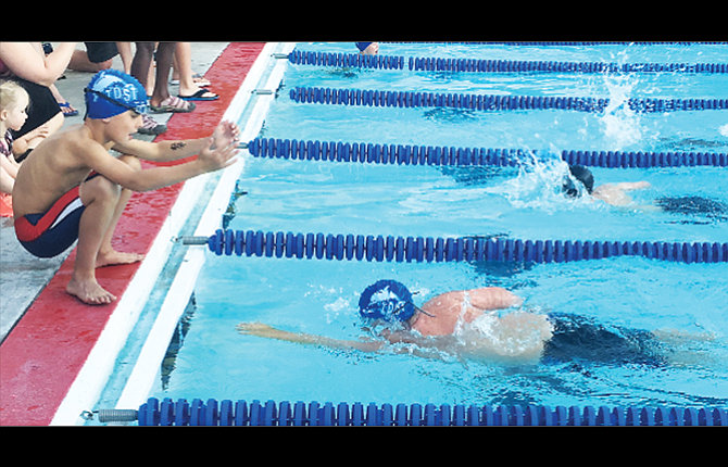 The Dalles swim team member, Maverick Varland, on left, cheers on his teammate Carter Randall during the 10-and-under 200-yard freestyle event at the John Day Invitational held this past weekend. Randall scored his only win on the day with a final time of three minutes and 7.6 seconds. In all, Randall, Varland and Lydia DiGennaro combined for four firsts, 11 seconds and two thirds to lead the team.