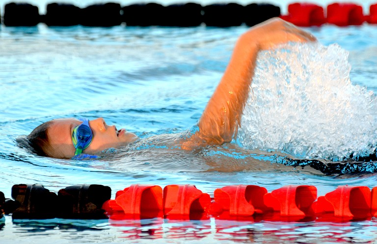 Sunnyside's Jaden Kaptein competes in the 50 meter backstroke in the 8 and younger division against Grandview on Monday.
