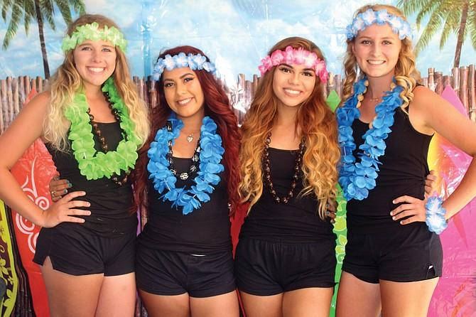 Sunnyside cheerleaders, from left, Kayla Van Wieringen, Destiny Fonseca, Hollie Tate and Annalies Roskamp raised funds Saturday by having their photo taken with swim meet-goers.