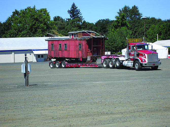 A caboose on its way to the Willamette Heritage Center in Salem made a brief, and mistaken, stop at the Polk County Museum on Saturday. Excited to see the old wooden caboose  at the museum, David Moellenberndt, president of the Polk County Historical Society, offered to keep it, but instead took photos before it was on to its true destination.
