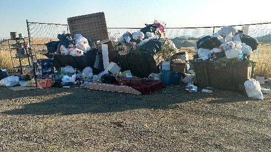 Pictured are dumpsters on Butcher Creek Road, near the Harpster Grade Road.