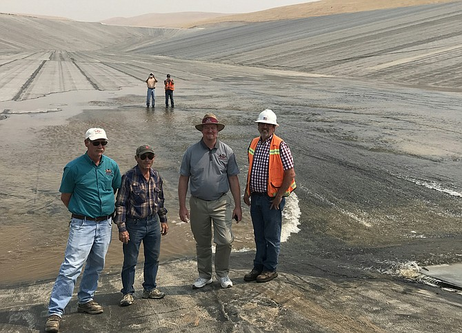Roza Watermaster Clay Bohlke, Vice President Jim Willard, Manager Scott Revell and consulting Engineer Stan Schweissing observe pump testing at the Washout Canyon re-regulation reservoir.