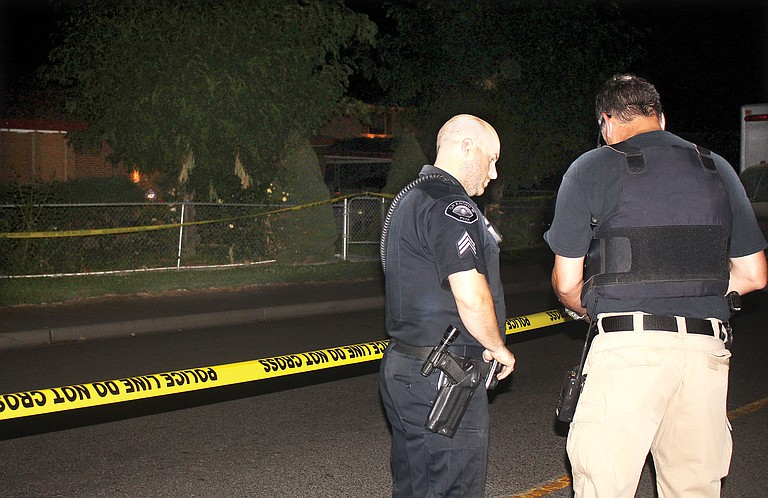 Grandview police cordon off the area around a home at 115 Wilson Highway late Wednesday night following a shooting.