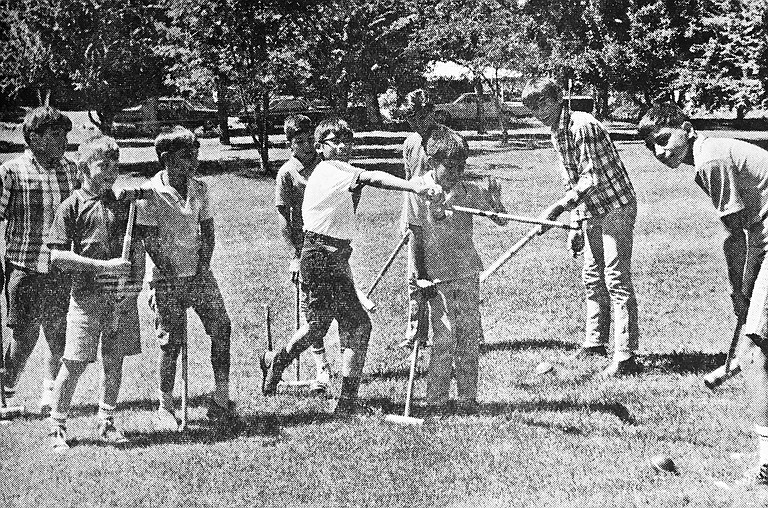 1967: These boys found the game of croquet to be a popular activity at Central park as part of the summer park program.