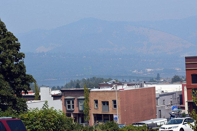 A SHEEN OF SMOKE hovers above the Columbia River, seen from downtown Hood River. Smoke from wildfires — close and distant — has made the air quality fluctuate across the region.
